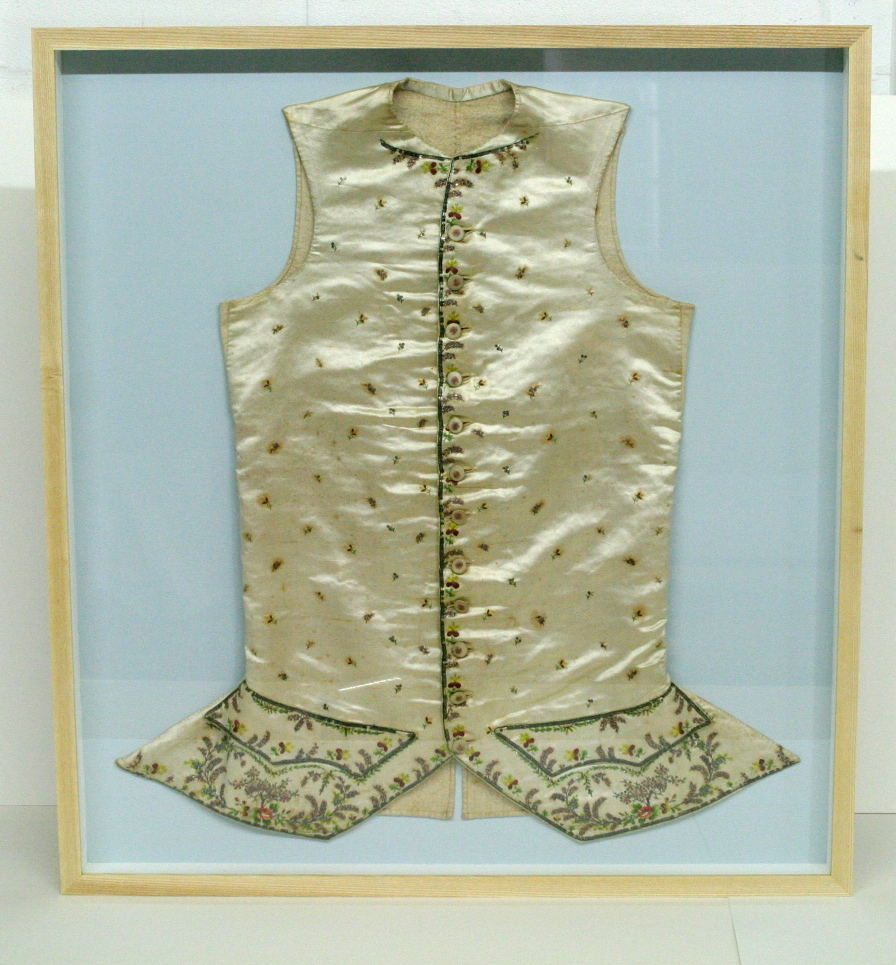 300 year old waist coat. Framed to conservation standards in a box frame.