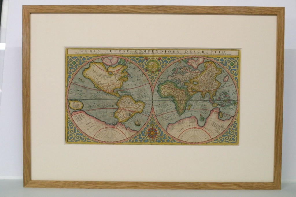 Antique map window mounted in an oak frame with museum glass